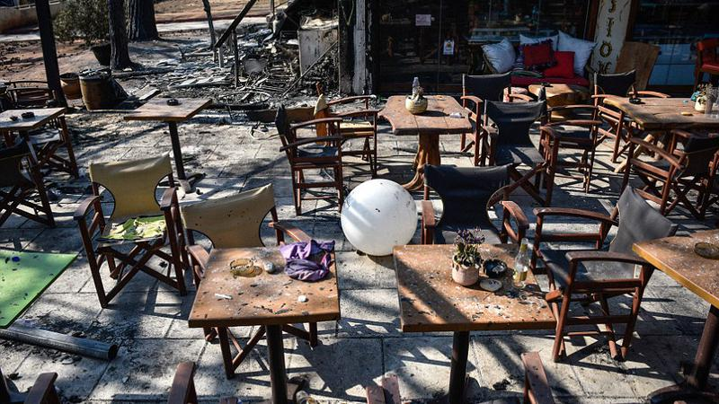 Bottles and belongings are left on tables at a fire damaged bar in Mati, Greece on July 25 2018. Wildfires ravaged houses and properties in the seaside resort earlier this week, killing 79 people. | Sursa: Peter Summers